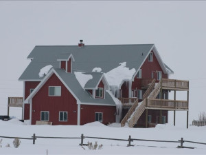 Looking east in winter at Fall River Lodge exterior.