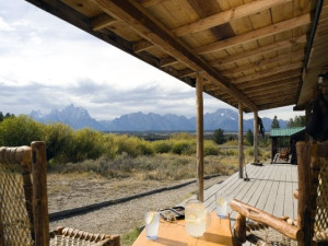 Cabin porch at Triangle X Ranch.