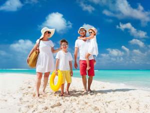 Family on beach near Vacome.