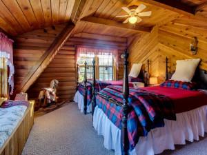 Vacation rental bedroom at Vacasa Rentals Mt Hood.