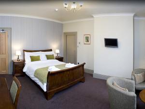 Guest room at Palmer Flatt Hotel.