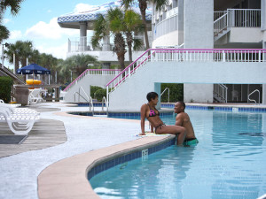 Couple by pool at Crown Reef Resort.
