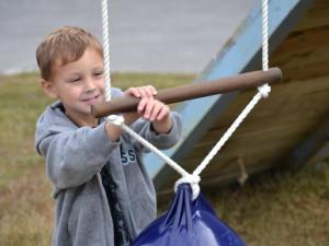 Child playing on playground at Buzzard Rock Resort and Marina.