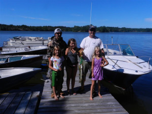 Family on dock at Deluxe Camp.