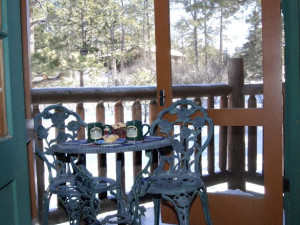 Private balcony off one of the guest rooms Rocky Mountain Lodge & Cabins.
