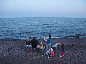 Family on the beach at Bluefin Bay on Lake Superior.