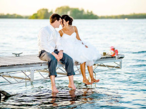 Couple on dock at Bay Pointe Inn.