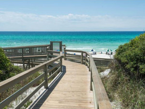 Boardwalk to the beach at Dune Real Estate Company.