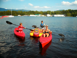 Family kayaking at Contessa Resort.