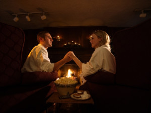 Couple by the fire at HideAway Country Inn.