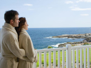 Couple on balcony at The Cliff House Resort & Spa.