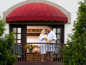 Couple on the balcony at La Tourelle Resort & Spa.