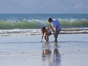 Collecting shells on the beach at Glorietta Bay Inn.