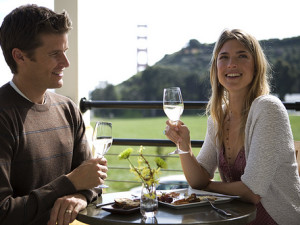 Couple dining outside at Cavallo Point Lodge.