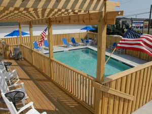 Porch around the pool at Outer Banks Inn.
