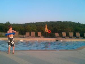 Kid by pool at Vacation Home in Branson.