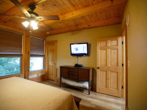 Cabin bedroom at Geronimo Creek Retreat.