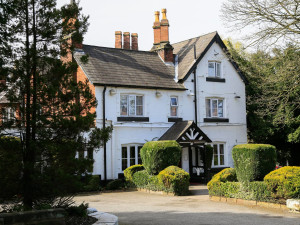 Exterior view of Lymm Hotel.