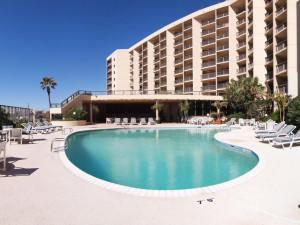 Outdoor pool at The Dunes Condominiums.