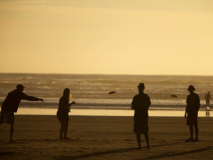 Family on beach at Seabrook Cottage Rentals.