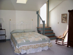 Bedroom at Cornerstone Suites.