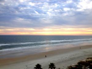 Walk along the beach at Plaza Resort & Spa.