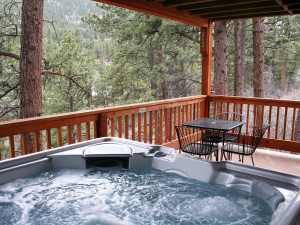 Cottage deck and jacuzzi at Lazy R Cottages.
