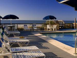 Lounge chairs by pool at Ocean Isle Inn.