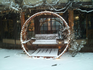 Swing in snow at Inn on La Loma Plaza.
