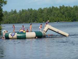 Water trampoline and slide at River Point Resort & Outfitting Co.