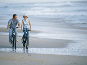 Biking on the Beach at Vacation Time