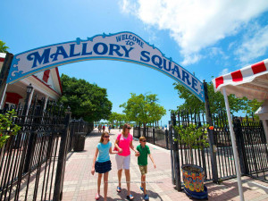 Family in Mallory Square near Sunrise Suites Resort.