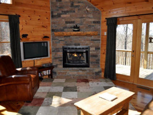 Cabin living room at Cuddle Up Cabin Rentals.