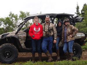 Family with ATV at Alaska's Gold Creek Lodge.