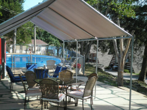 Poolside patio at Calm Waters Resort.