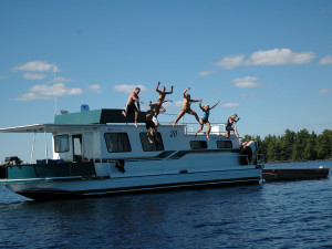 Jumping into the lake at Rainy Lake Houseboats.