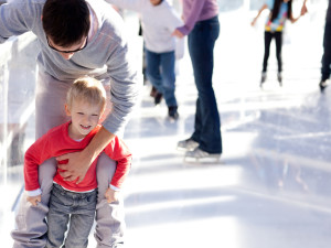 Father and child ice skating at Aspen Square Condominium Hotel.