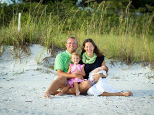 Family on beach at Lizzie Lu's Island Retreat.