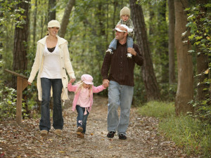 Family hiking in the woods at Whispering Woods Resort.