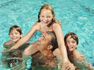 Family in pool at The Landing Resort.