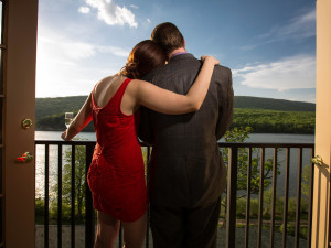 Couple on private balcony at Rocky Gap Casino Resort.