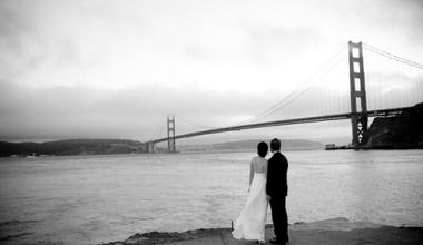 Wedding couple view the San Fransisco bridge near Cavallo Point Lodge.