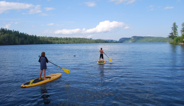 Paddle boarding at Clearwater Historic Lodge.