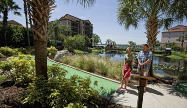 Family playing mini golf at Westgate Lakes Resort.