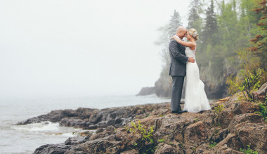 Wedding couple by shore at Superior Shores Resort.