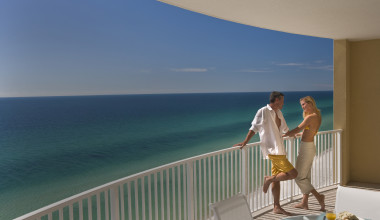 Couple on balcony at Sterling Resorts.