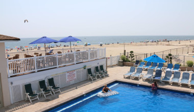 Outdoor pool and beach at The White Sands Oceanfront Resort & Spa.