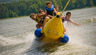 Family riding the banana boat at The Tyler Place Family Resort.