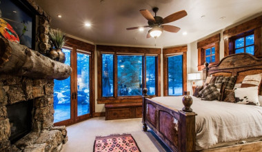 Rental bedroom at Utopian Luxury Vacation Homes.
