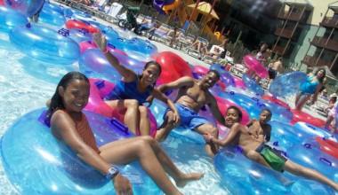 Family swimming at waterpark at Kalahari Waterpark Resort Convention Center.